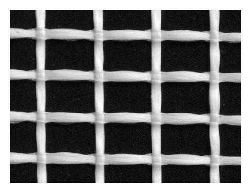 (a) textile out of alkali resistant glass fibres (AR-glass)