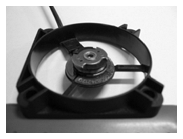 (a) Photograph of the stator base