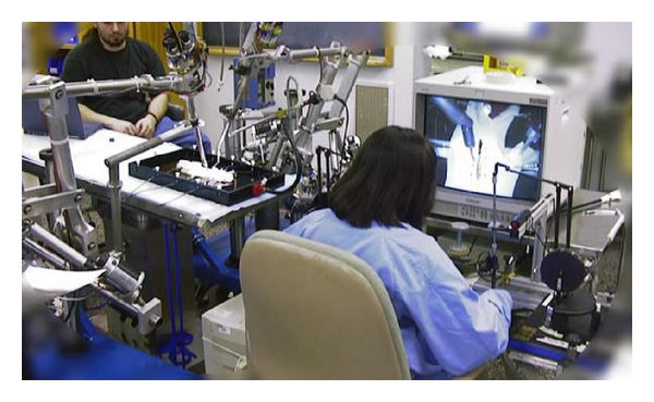 (b) Robotic telesurgical workstation by UCB & UCSF
